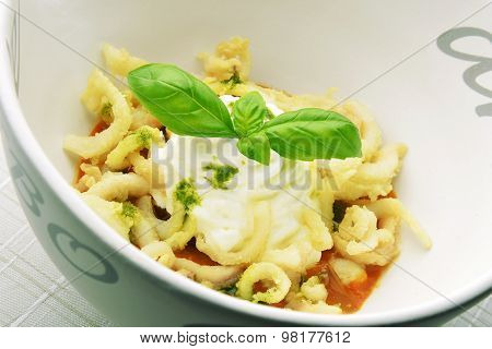 Appetizer Bowl Of Gazpacho With Fried Calamari Squid And Basil Mousse