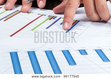 Hand Pointing A Finger At The Chart