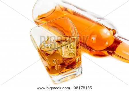Top Of View Of Whiskey Near Bottle On White Background With Reflection