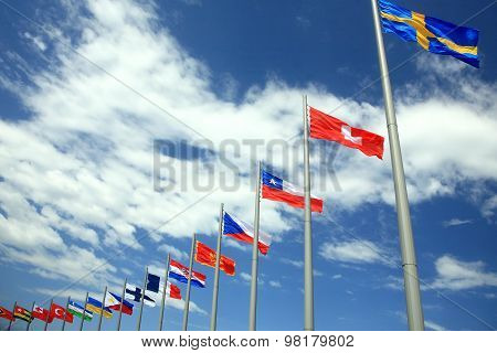 Flags Of The Different Countries Against The Sky