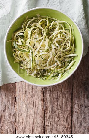 Useful Raw Zucchini Pasta In A Bowl Close Up. Vertical Top View