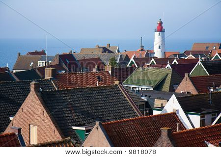 View At The Lighthouse And Roofs Of An Old Fishing Village In The Netherlands