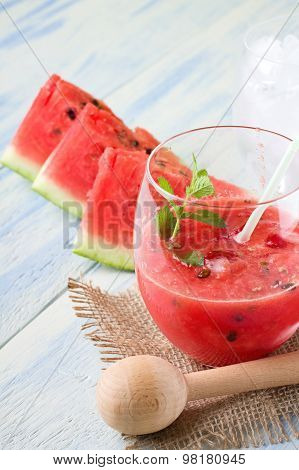 Mixed Melon In A Glass With Ice And Straw