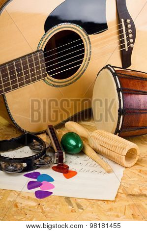 Several Music Instruments On Osb Board