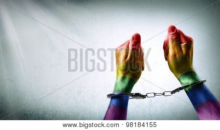 handcuffed hands - denunciation of the criminalization of homosexuality
