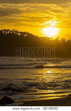 Golden Sky At Sunset On Desert Tropical Beach