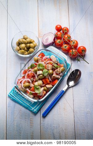 fish salad with swordfish tomatoes green olives and onion