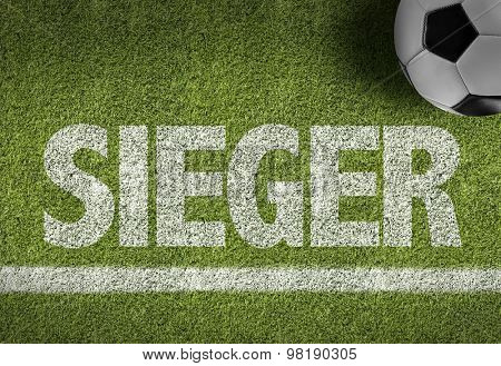 Soccer field with the text: Winner (in German)