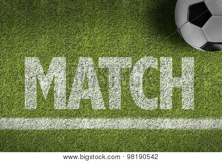 Soccer field with the text: Match