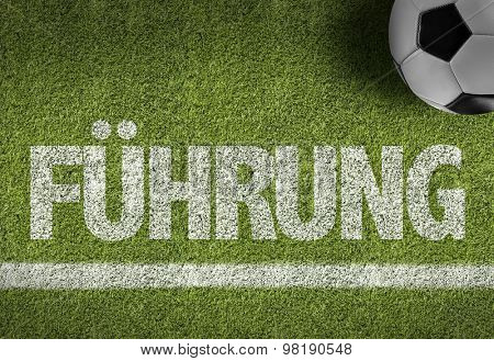 Soccer field with the text: Leadership (in German)