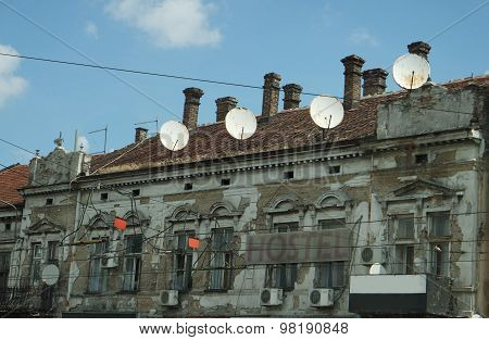 Old house occupied by satellite antennas