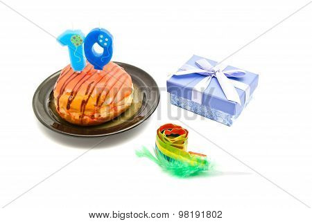 Donut With Ten Years Birthday Candle, Whistle And Gift On White