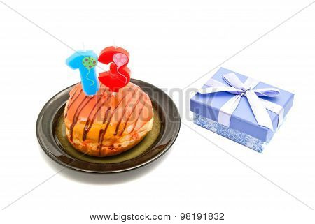 Donut With Thirteen Years Birthday Candle And Gift On White