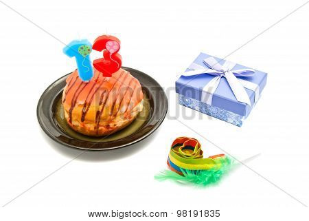 Donut With Thirteen Years Birthday Candle, Whistle And Gift On White