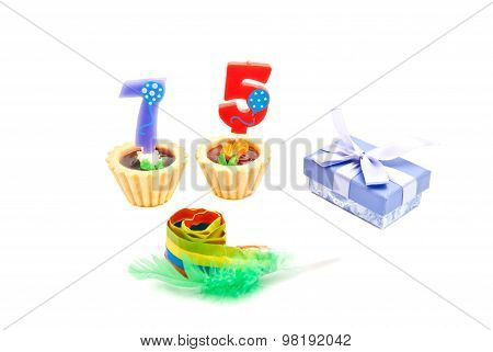 Cakes With Seventy Five Years Birthday Candles, Whistle And Gift
