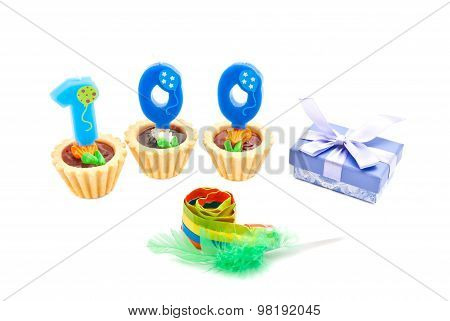 Cakes With One Hundred Years Birthday Candles, Whistle And Gift On White