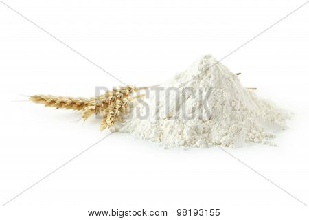 Heap Of Wheat Flour With Spikelets Isolated On White