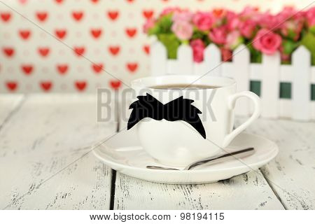 cup with paper mustache