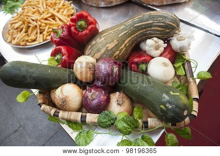 Bread, fresh vegetables zucchini garlic bell pepper onion, at the fair in Spain.