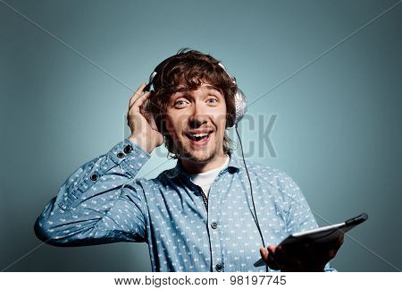 Closeup Portrait Surprised Funny Looking Young Hipster Man Holding Tablet Pc, Reading Bad News On Di
