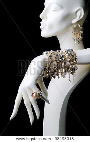 Mannequin With Jewelry Rings Bracelets And Earrings