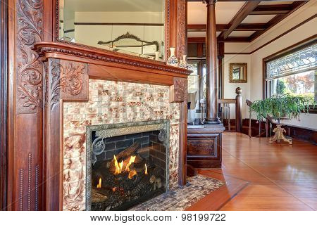 Well Kept Fireplace With Nice Decor.