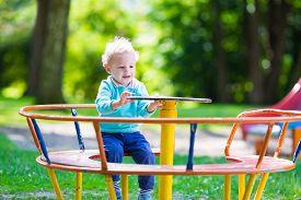 picture of playground school  - Little boy on a playground - JPG