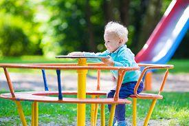 pic of playground school  - Little boy on a playground - JPG