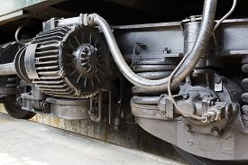 picture of passenger train  - Old authentic green passenger trains in a depot for renovation before being used for tourist trips across Europe - JPG