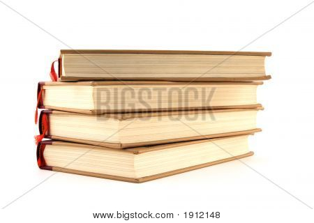 Four Hardcover Books On White Background