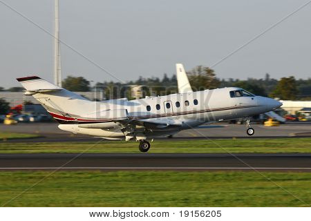 small business jet taking off from the runway