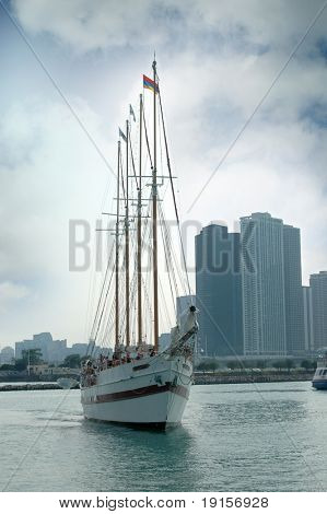 Sailboat in Chicago with skyline in the background