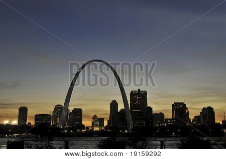 Saint Louis Skyline with the Mississippi river in front after sunset