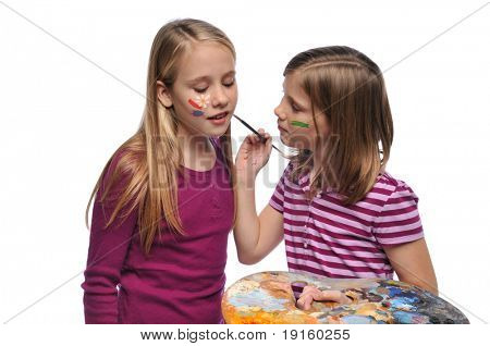 Young Girls doing face paint isolated on a white background