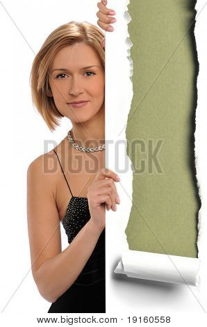 Woman holding a torn paper against a green background
