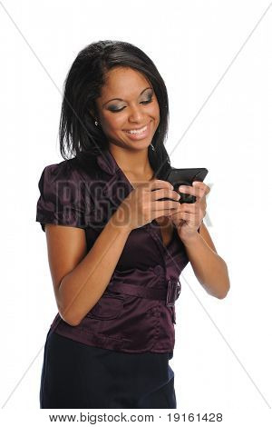 Young Black woman text messaging and smiling isolated on a white background