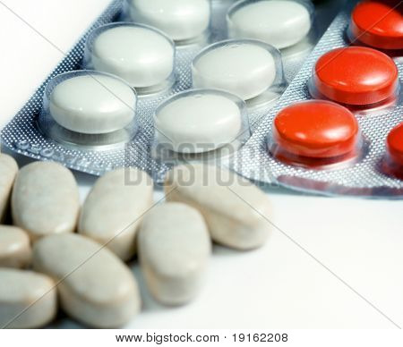 Closeup on medical pills on white background