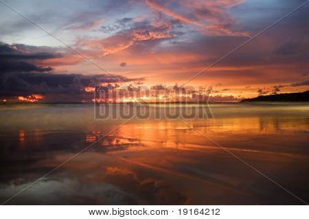 Sunset on tropical beach. Andaman sea. Phuket island. Kingdom Thailand
