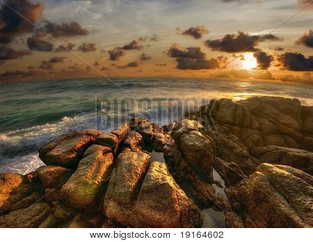 Great sunset on tropical beach. Andaman sea. Phuket island. Kingdom Thailand