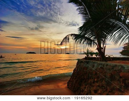 Sunset on tropical beach. Siam bay. Province Trat. Koh Chang island. Kingdom Thailand