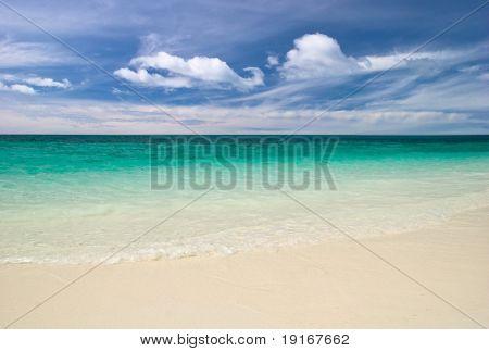 White sand tropical beach. Photographed on uninhabited island Tulai, near Tioman island. Malaysia