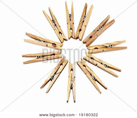 Wooden clothes pegs, isolated on white.