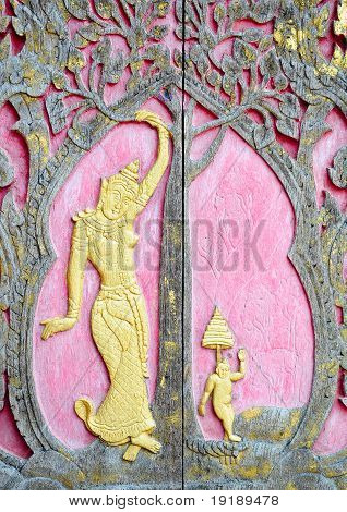 Native Thai style wood carving decorated in temple.  Sculptures in the temple.