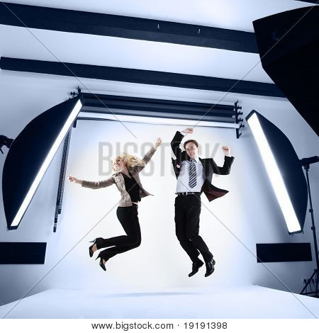 businessman and woman in a modern photo studio