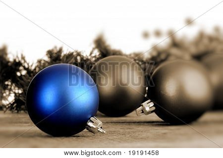 Blue Sepia Toned Christmas Balls On An Old Vintage Table