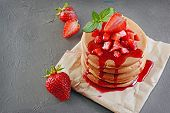 Tasty Breakfast. Homemade Pancakes And Berry Syrup With Fresh Strawberry poster