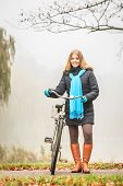 Happy Active Woman With Bike In Autumn Park. poster