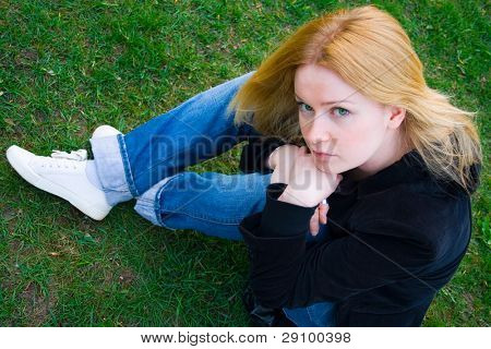 pretty young blonde over green grass background