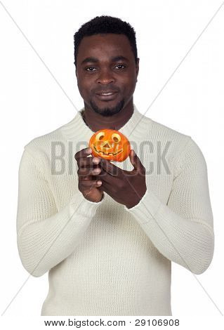 Attractive african man with a orange pumpkin isolated on a over white background