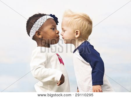 Diverse Little Kids about to Kiss